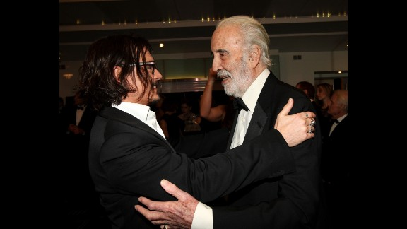 """Johnny Depp greets Lee at the London premiere of """"Alice in Wonderland"""" in 2010. Lee voiced the Jabberwocky in the Tim Burton film."""