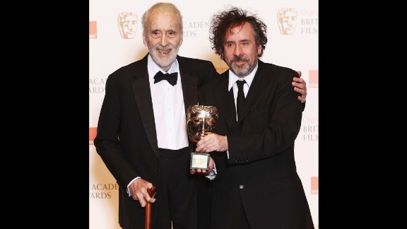 Director Tim Burton presents Lee with the Academy Fellowship, a lifetime achievement award, at the British Academy Film Awards in 2011.