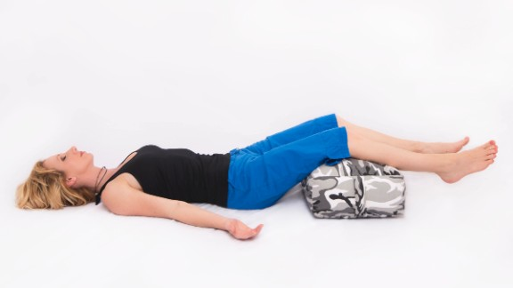 Resting on your back, place your legs on a bolster or pillow. Let your arms rest at your sides. Raising your legs up above your heart promotes venous blood flow to improve circulation and reduce swelling. Changing your relationship with gravity also takes noticeable physical stress off your body.