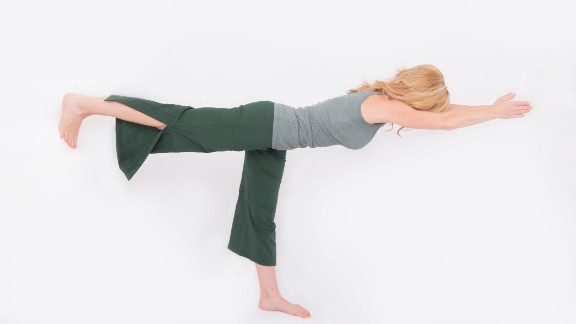 Shift your weight into your right leg and begin to take weight off your left leg. Exhale fully to drop your rib cage and have better access to core muscles to help stabilize you. When you feel steady, reach your arms forward and left leg back along a horizontal line. Try to hold it for two or three breaths. Repeat on the other side.