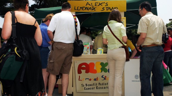 People in Elmont, New York, gather around Alex's Lemonade Stand, which was raising money for pediatric cancer research in June 2005. Alexandra Scott was the 8-year-old founder. She was diagnosed with neuroblastoma and she opened her first lemonade stand in July 2000.