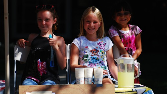 Three girls set up a neighborhood lemonade stand in July 2010.