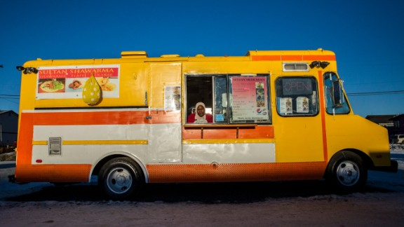 Adam sells falafel and shawarma to hungry customers from her food truck parked on the main drag.