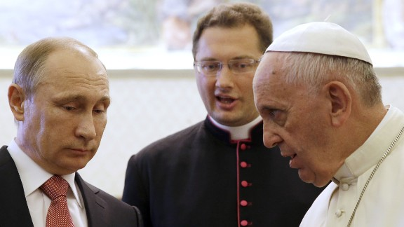 "Russian President Vladimir Putin, left, meets Pope Francis at the Vatican on Wednesday, June 10, 2015. The Pope gave Putin a medallion depicting the angel of peace, Vatican spokesman Federico Lombardi said. The Vatican called it ""an invitation to build a world of solidarity and peace founded on justice."" Lombardi said the pontiff and President talked for 50 minutes about the crisis in Ukraine and violence in Iraq and Syria."