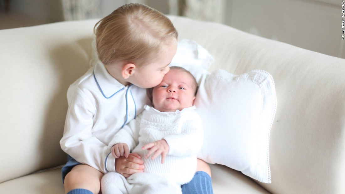 "Britain's Prince George kisses his little sister, Princess Charlotte, in one of four photos released by Kensington Palace on Saturday, June 6. <a href=""http://www.cnn.com/2015/06/06/europe/uk-royal-princess-charlotte-photos/index.html"" target=""_blank"">The photos</a> were taken by the children's mother, Catherine, Duchess of Cambridge."