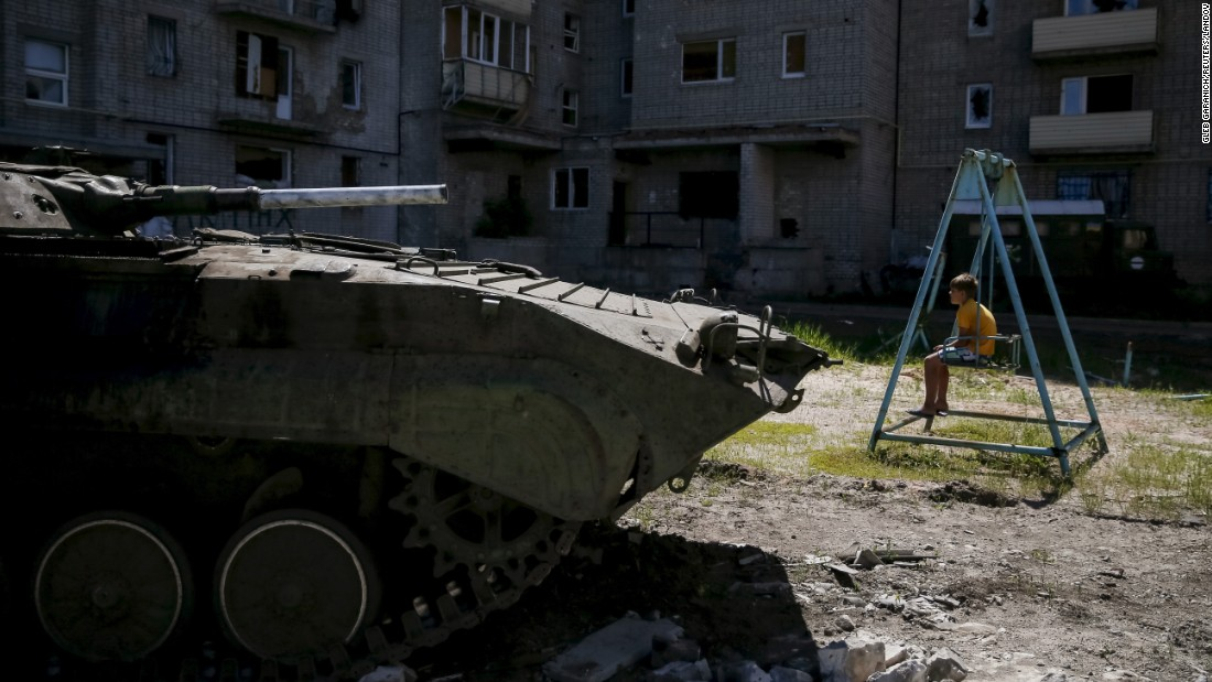 "A boy in Avdiivka, Ukraine, sits on a swing near his home -- and an armored military vehicle -- on Sunday, June 7. <a href=""http://www.cnn.com/2015/01/23/world/gallery/ukraine-crisis-2015/index.html"" target=""_blank"">Fighting continues in eastern Ukraine</a> despite a fragile ceasefire agreed upon in February. More than 6,400 people have been killed in the conflict since April 2014, the United Nations says."