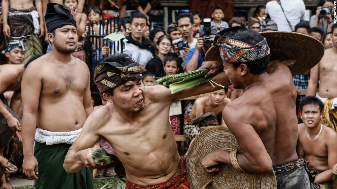 Two men from the Indonesian village of Tenganan Pagringsingan fight each other with thorny pandanus leaves on Monday, June 8. It's one of the rituals of Usaba Sambah, an annual monthlong ceremony demonstrating respect to the Hindu god of war.