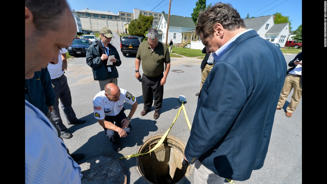 "New York Gov. Andrew Cuomo, right, is shown the manhole where two convicted murderers escaped from a maximum-security prison in Dannemora, New York, on Saturday, June 6. <a href=""http://www.cnn.com/2015/06/09/us/gallery/prison-escapes/index.html"" target=""_blank"">See more amazing prison escapes</a>"
