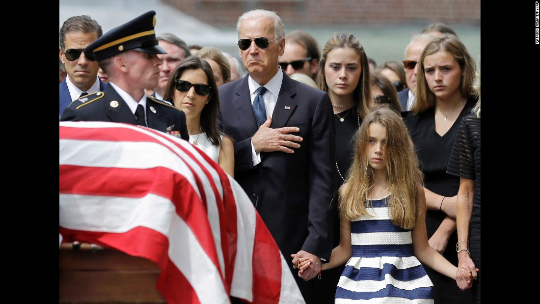 "Vice President Joe Biden puts his hand over his heart as he watches an honor guard carry the casket of his late son, former Delaware Attorney General Beau Biden, on Saturday, June 6. Beau Biden died at the age of 46 after a battle with brain cancer. ""He did in 46 years what most of us could not do in 146,"" <a href=""http://www.cnn.com/2015/06/06/politics/beau-biden-funeral/"" target=""_blank"">President Barack Obama said during the eulogy.</a> ""He left nothing in the tank. He was a man who led a life where the means were as important as the ends."""
