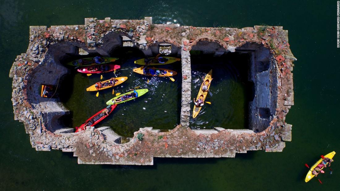 A canoe club visits the ruins of a church near Tvarditsa, Bulgaria, on Monday, June 8. The church was part of a village that was flooded -- and abandoned -- during a dam construction in 1965.