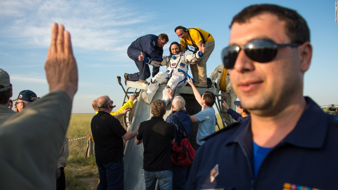 Cosmonaut Anton Shkaplerov is helped out of his spacecraft just minutes after landing in a remote area near the town of Zhezkazgan, Kazakhstan, on Thursday, June 11. Shkaplerov, American astronaut Terry Virts and Italian astronaut Samantha Cristoforetti had just returned to Earth following a mission aboard the International Space Station.
