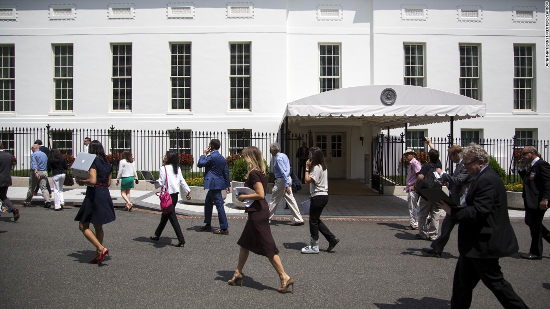 "Journalists walk past the West Wing of the White House after a bomb threat on Tuesday, June 9. The Secret Service said the threat <a href=""http://www.cnn.com/2015/06/09/politics/hearing-evacuated-bomb-threat-tsa/"" target=""_blank"">specifically targeted the press briefing room.</a> The room was checked and cleared."