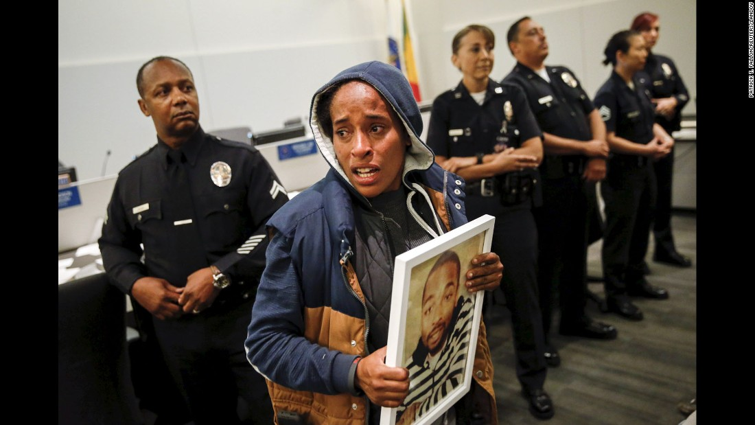 "A woman protests the death of Ezell Ford during a meeting of the Los Angeles Police Commission on Tuesday, June 9. Ford, 25, was an unarmed black man shot and killed by police in August. A civilian committee tasked with oversight of the Los Angeles Police Department <a href=""http://www.cnn.com/2015/06/10/us/los-angeles-ezell-ford-case/"" target=""_blank"">found that one of the officers involved in the shooting acted against police department policy throughout the confrontation with Ford.</a> And it said a second officer was unjustified in how he initially drew his gun. The committee's decision, however, is not legally binding. The district attorney's office, which is conducting its own investigation, will make the final determination whether to file charges. Two prior assessments by Police Chief Charlie Beck and an independent investigator found no fault with police."