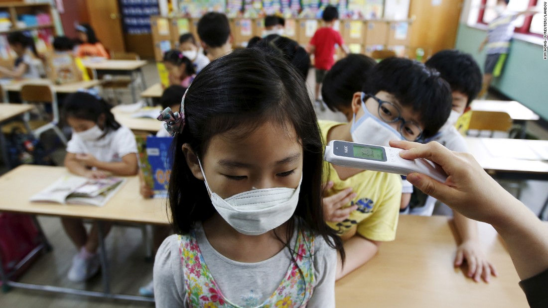 "A student receives a temperature check at an elementary school in Seoul, South Korea, on Tuesday, June 9. The country <a href=""http://www.cnn.com/2015/06/11/asia/south-korea-mers-outbreak/"" target=""_blank"">is attempting to curb the spread of the MERS virus</a> for a third week. Fourteen new cases of Middle East Respiratory Syndrome -- one of them a pregnant woman -- were confirmed Thursday, June 11. That brings the total number of cases to 122."