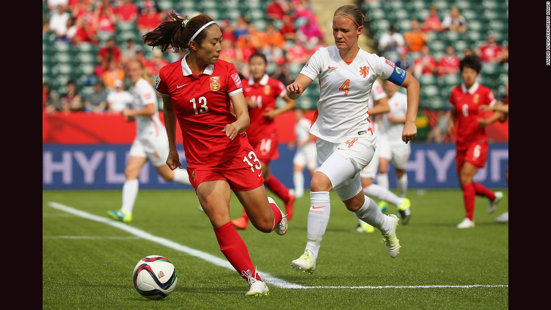 Mandy Van Den Berg of the Netherlands, right, defends Tang Jiali of China.