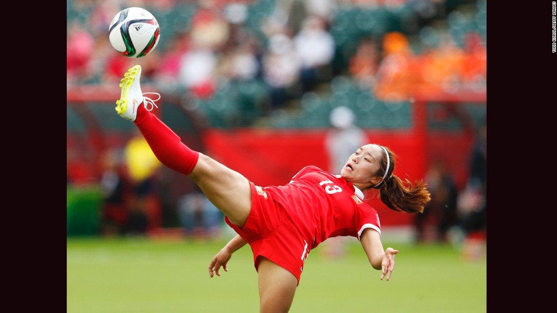 Tang kicks the ball during the Netherlands match.