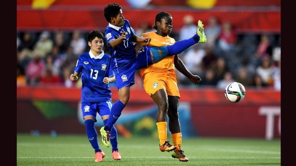 Anootsara Maijaren of Thailand, center, challenges Christine Lohoues of Ivory Coast during a Women