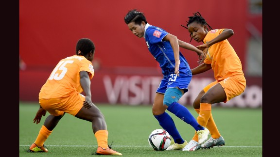 Nisa Romyen of Thailand tried to protect the ball from Lohoues, left, and Fatou Coulibaly.