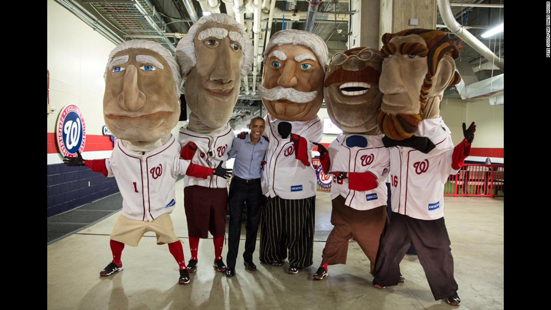 "U.S. President Barack Obama takes a photo with the ""Racing Presidents"" of the Washington Nationals baseball team on Thursday, June 11. The mascots, which race at every Nationals home game, represent former U.S. Presidents -- from left, George Washington, Thomas Jefferson, William Howard Taft, Theodore Roosevelt and Abraham Lincoln."
