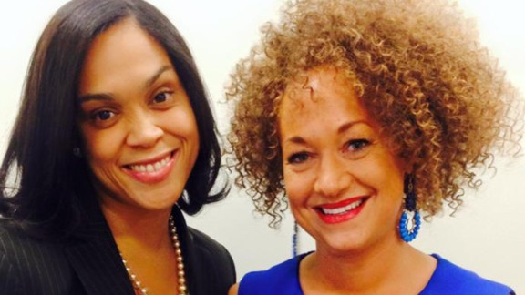 """Dolezal poses for a picture with prosecutor Marilyn Mosby. Dolezal's mother said on Friday, June 12, that her daughter """"has not explained to us why she is doing what she's doing and being dishonest and deceptive with her identity."""""""