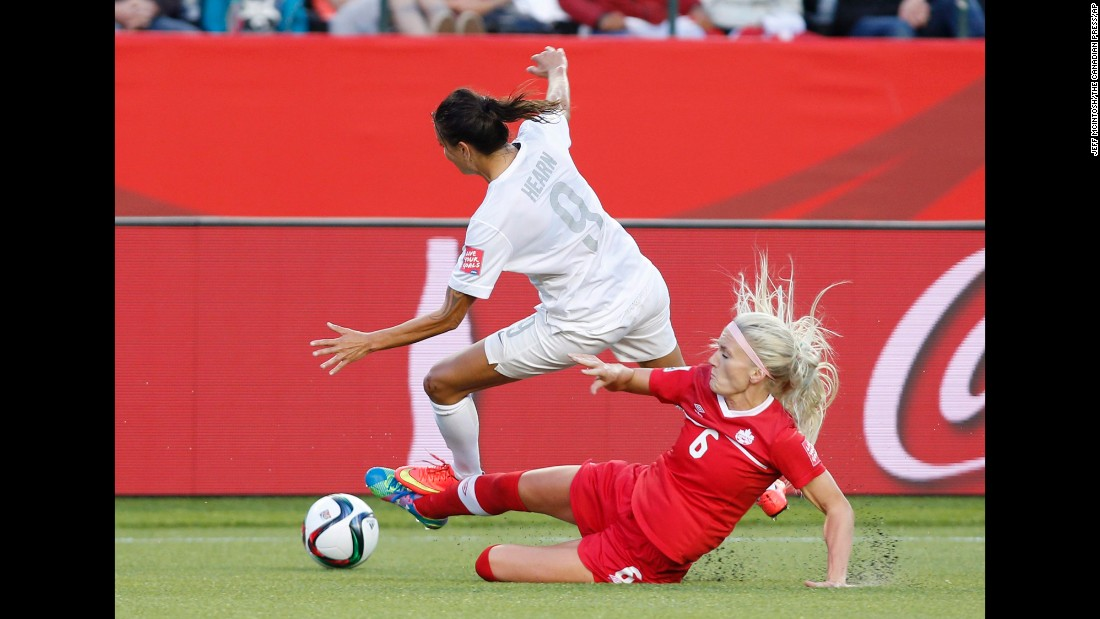 Canada's Kaylyn Kyle defends against New Zealand's Amber Hearn.