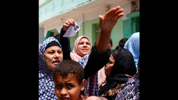 Mothers in Burj Mughayzil, Egypt, swarm around a CNN crew desperate for possible news of their missing sons. Many desperately poor families in Burj Mughayzil risk their children's lives by sending them to Italy on smuggler boats so that they can earn money to send home. But the risks are great, and the reality is more likely to be death at sea or detention on arrival.