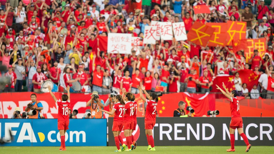 China players celebrate with supporters in Edmonton following their 1-0 win against the Netherlands on June 11.