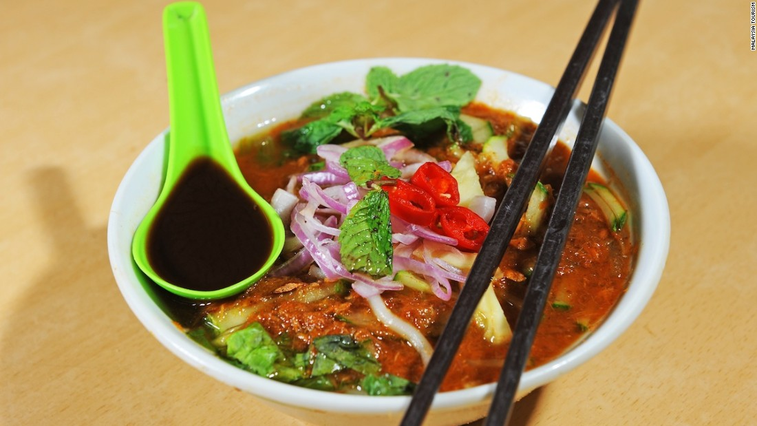 "Considered one of the national dishes, spicy noodle soup called ""Laksa"" typically features fish or prawns and lots of chili."