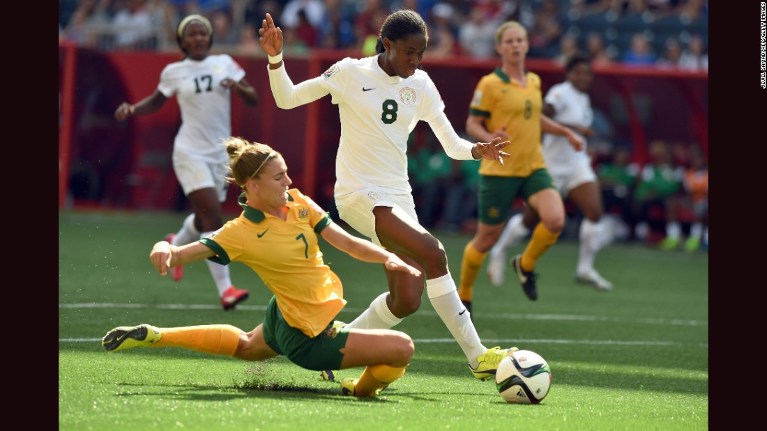 Nigeria forward Asisat Oshoala, right, is challenged by Australia defender Steph Catley during a match June 12 in Winnipeg. Australia won 2-0.