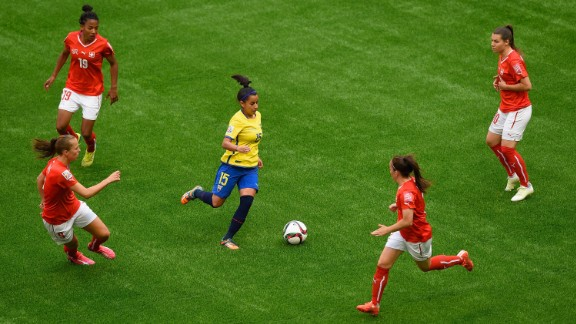 Ana Palacios of Ecuador is surrounded by Swiss defenders during a match June 12 in Vancouver. Ecuador lost 10-1.