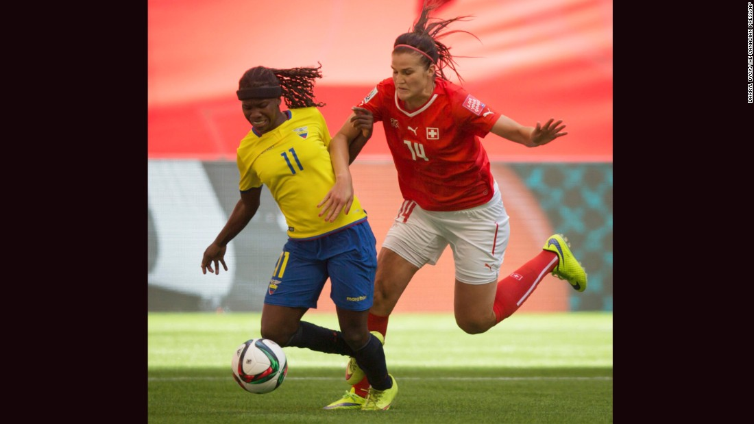 Ecuador's Monica Quinteros, left, fights off Switzerland's Rahel Kiwic.