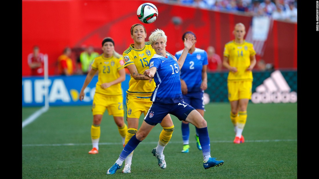 Megan Rapinoe of the United States tries to hold off Sjogran.