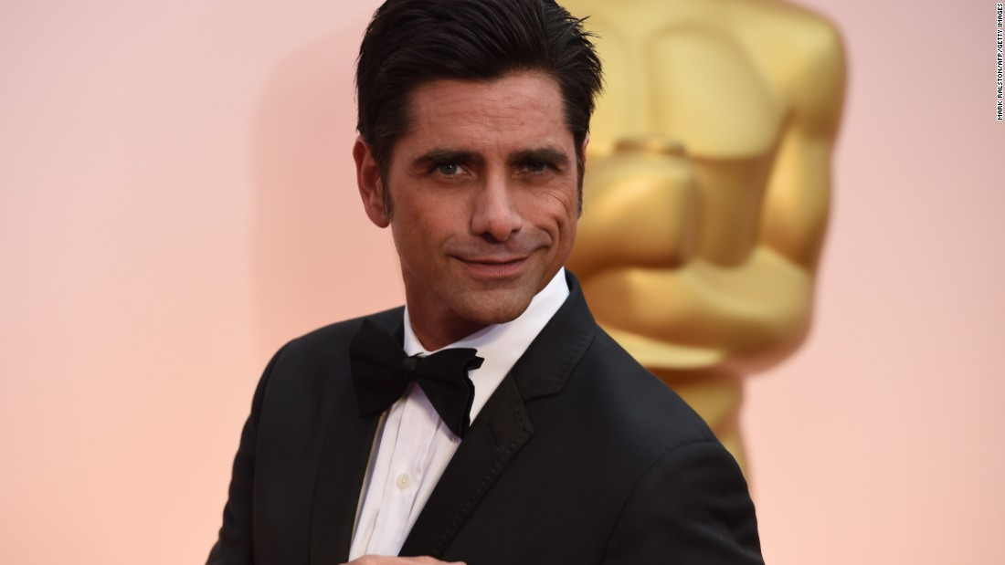 John Stamos announced in December that at the age of 54 he will become a dad as his fiancée actress Caitlin McHugh is pregnant. Other male celebs have become fathers in their later years, too.