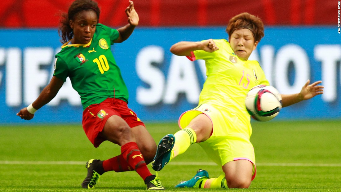 Jeannette Yango of Cameroon, left, and Yuika Sugasawa of Japan battle for a loose ball Friday, June 12, in Vancouver. Japan defeated Cameroon 2-1.