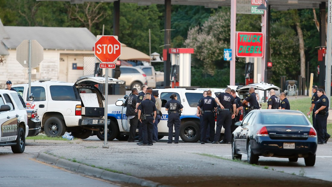 Police block the intersection of Dowdy Ferry Road and Interstate 45 near where the suspect was barricaded in a van.