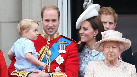 Prince George of Cambridge is held by Prince William, Duke of Cambridge as the family looks on from the balcony of Buckingham Palace.