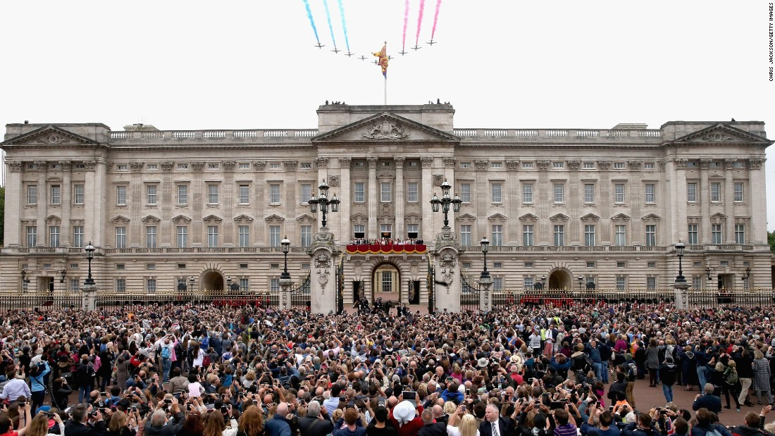 The Red Arrows fly over Buckingham Palace as part of the celebration.