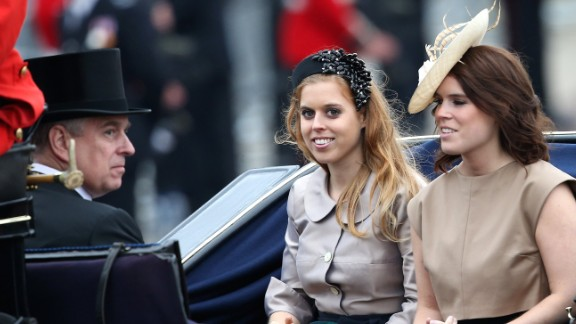 Prince Andrew, Duke of York, Princess Beatrice and Princess Eugenie arrive.