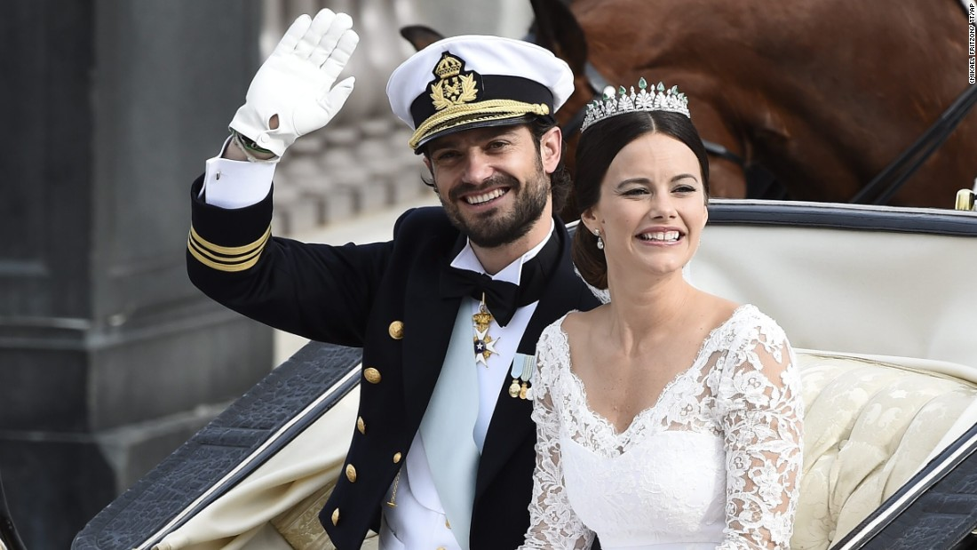 Sweden's Prince Carl Philip sits with his bride, Sofia Hellqvist, in a carriage after their wedding ceremony in Stockholm, Sweden, on Saturday, June 13. The 36-year-old prince and the 30-year-old former reality-TV star tied the knot Saturday at the Royal Palace chapel before five European queens, a Japanese princess and dozens of other blue-blooded guests.