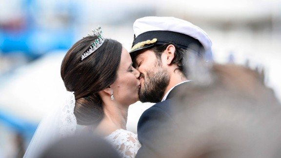 The newlyweds kiss after the ceremony.