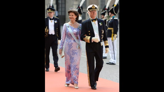 King Carl Gustaf and Queen Silvia arrive at the at the Royal Palace chapel for the wedding.