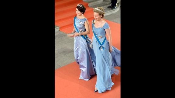 Crown Princess Mary of Denmark, left,  and Queen Mathilde of Belgium arrive.