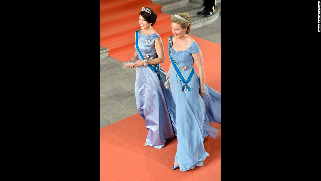 Crown Princess Mary of Denmark, left,  and Queen Mathilde of Belgium arrive.