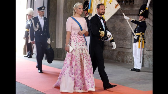 Crown Princess Mette-Marit and Crown Prince Haakon of Norway arrive for the wedding.