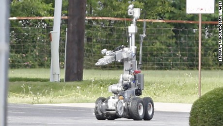 Police use a robot to gain access to the suspects armoured van, which authorities believed was rigged with explosives.