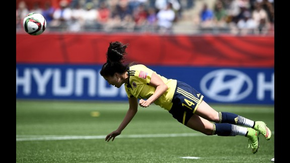 Colombian midfielder Nataly Arias heads the ball.
