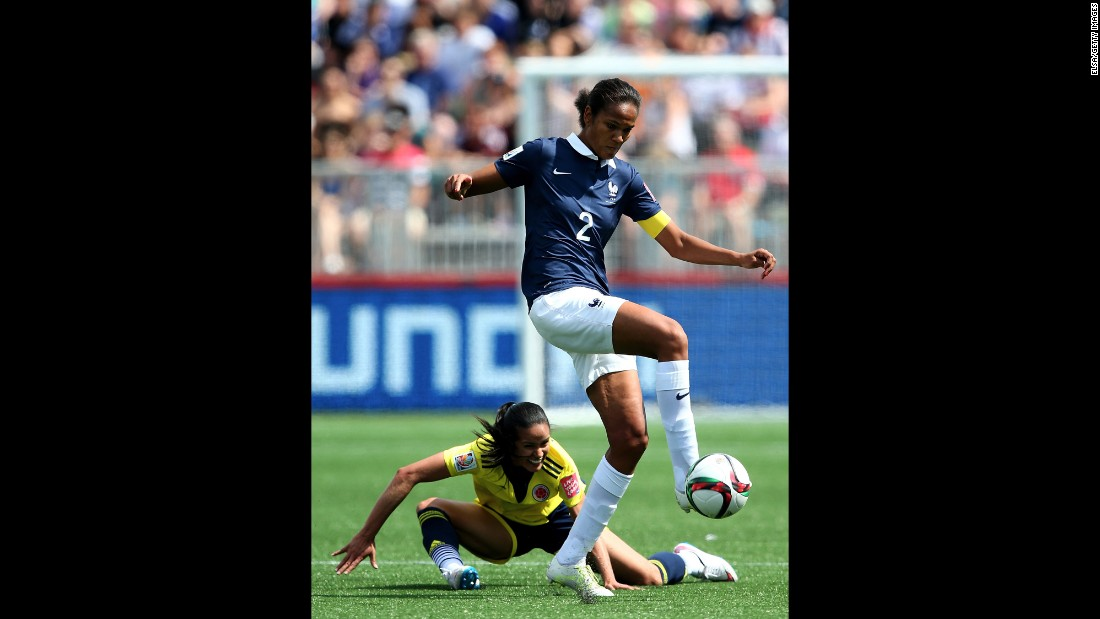 France's Wendie Renard takes the ball from Lady Andrade of Colombia.