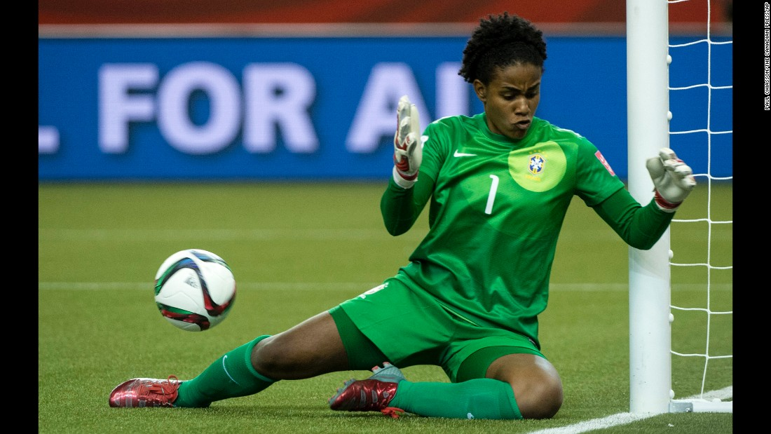 The ball rolls behind Brazilian goalkeeper Luciana as she makes a save.