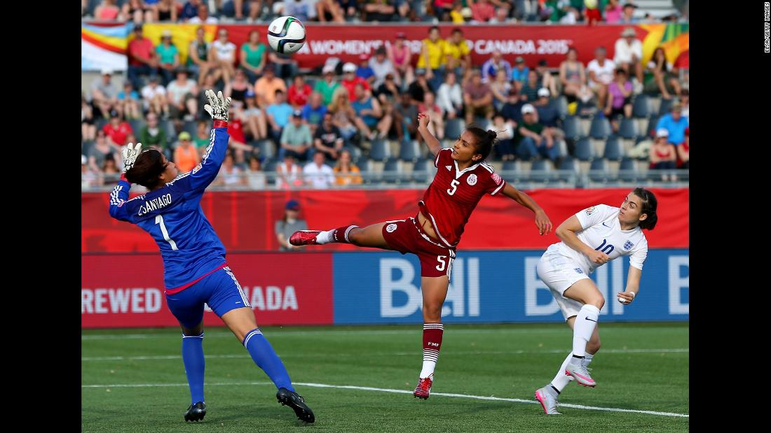 England's Karen Carney, right, gets a shot past Valeria Miranda and Cecilia Santiago of Mexico on Saturday, June 13. England won 2-1 in Moncton.