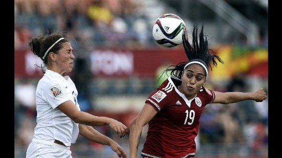 Mexican forward Renae Cuellar, right, competes with English midfielder Fara Williams.
